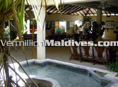 The lobby and reception area at Summer Island Maldives. Simple tropical resort hotel